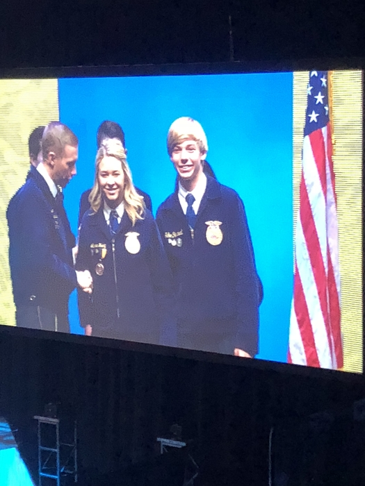 Jake and Lauren picking up our 3 Star Gold Emblem National Chapter Award