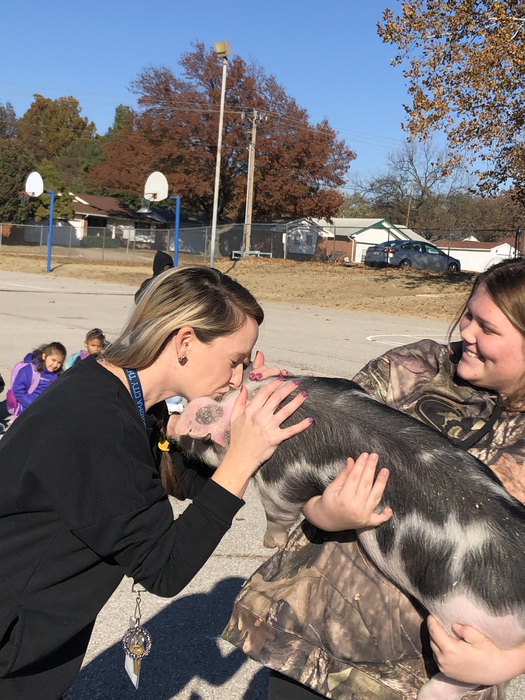 Raven Smith helped explain pigs to some kids in Putnam City after their teacher kissed the pig