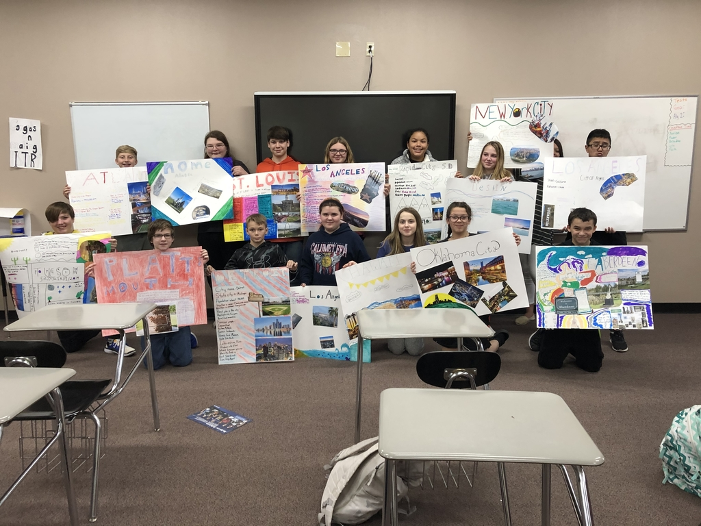 7th grade city poster presentations in Foster's room.