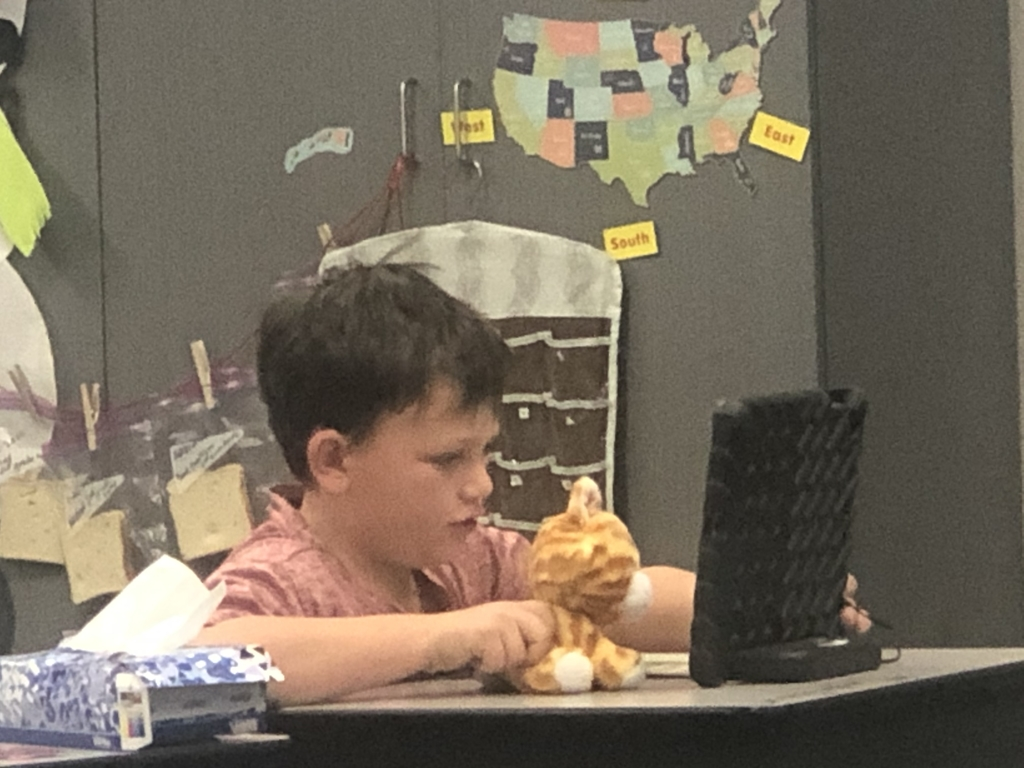 Cayden with a Reading Buddy