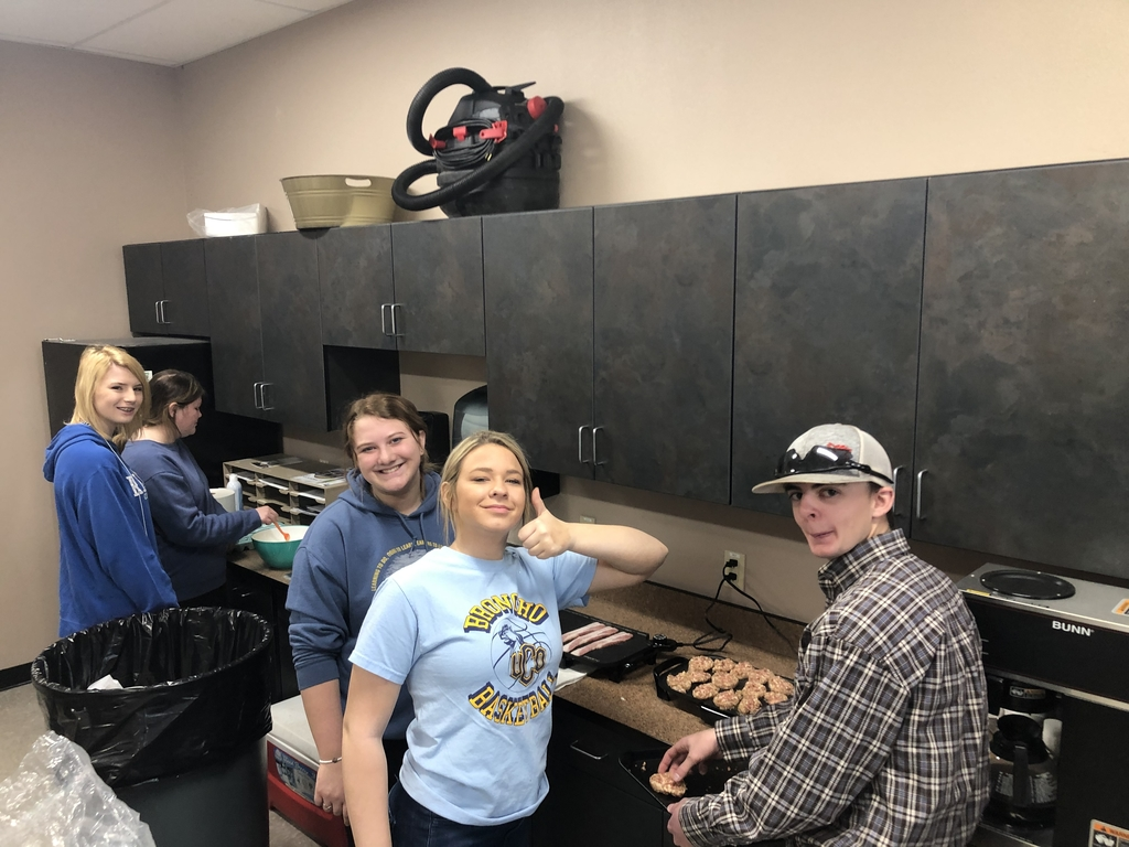 FFA members cooking for the teachers